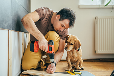 Man and his dog working on a home project