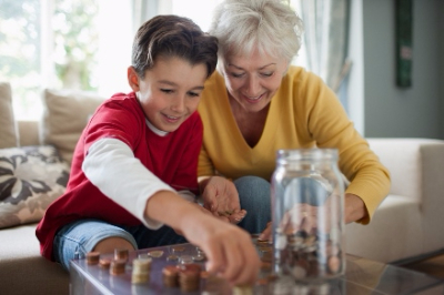 young boy and older woman counting money