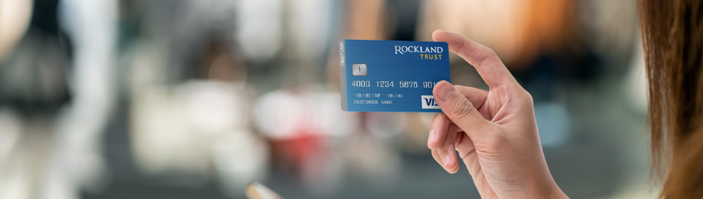 woman holding Rockland Trust consumer credit card